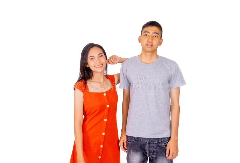 Young Asian boy and girl standing together in front of the camera white background. The Young Asian boy and girl standing together in front of the camera white royalty free stock image