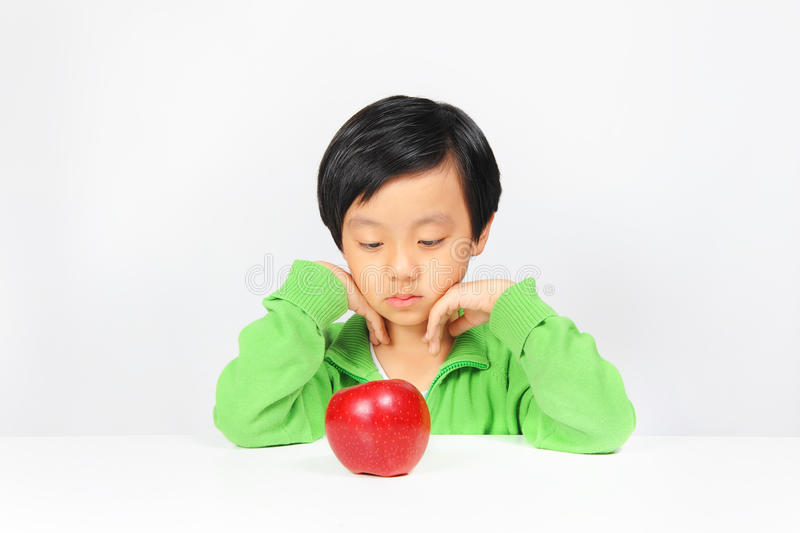 Young Asian Boy Reluctant To Eat Healthy Food Royalty Free Stock Images