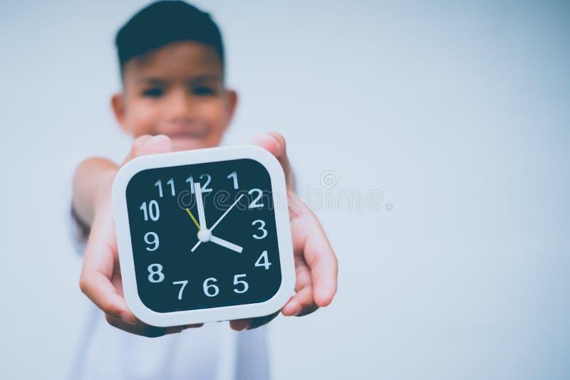 Young asian boy save time royalty free stock photos