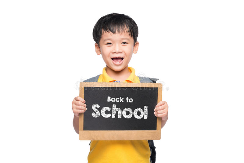 Young asian boy smile holding BACK TO SHCOOL chalkboard over white stock photos