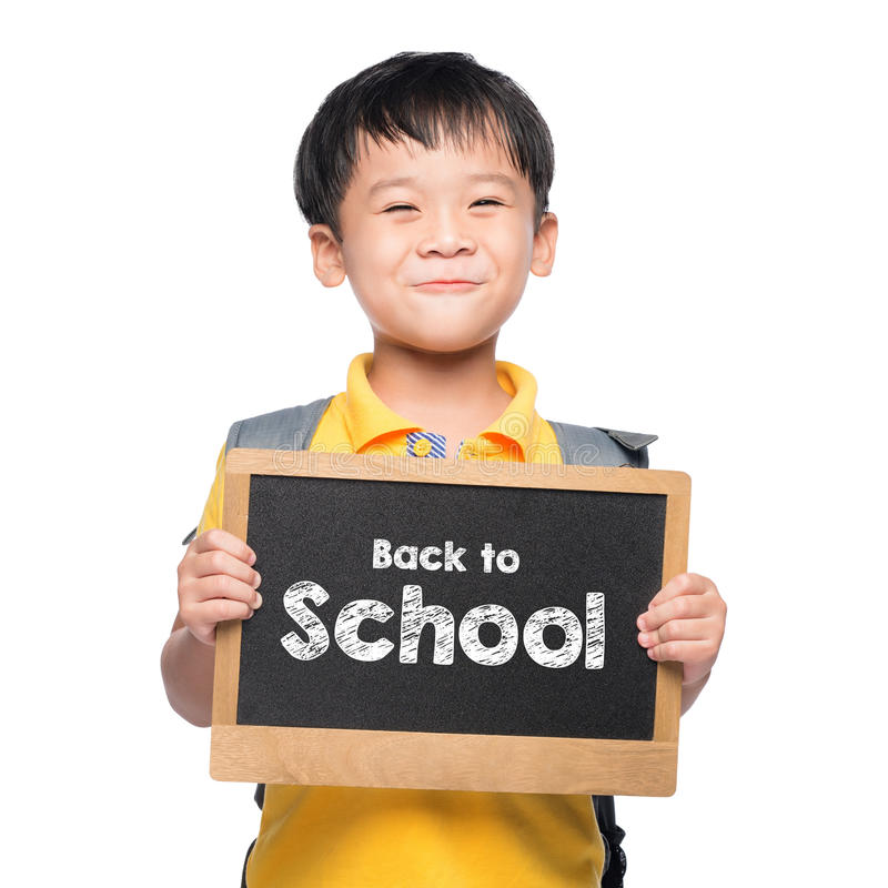 Young asian boy smile holding BACK TO SHCOOL chalkboard over white stock photography