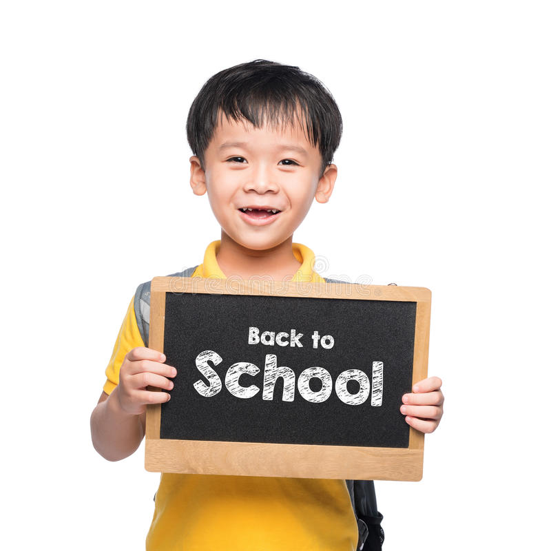 Young asian boy smile holding BACK TO SHCOOL chalkboard over white stock image