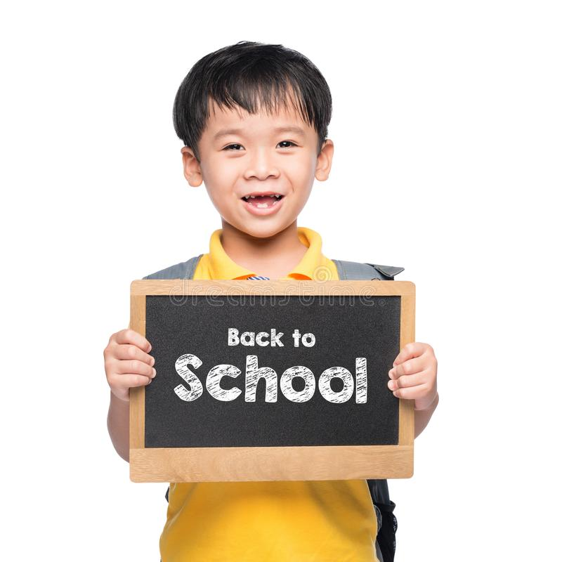 Young asian boy smile holding BACK TO SHCOOL chalkboard over white royalty free stock photos