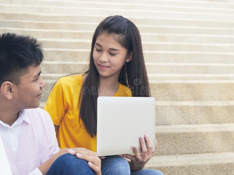 Young asian boy and womon of computer stock photography