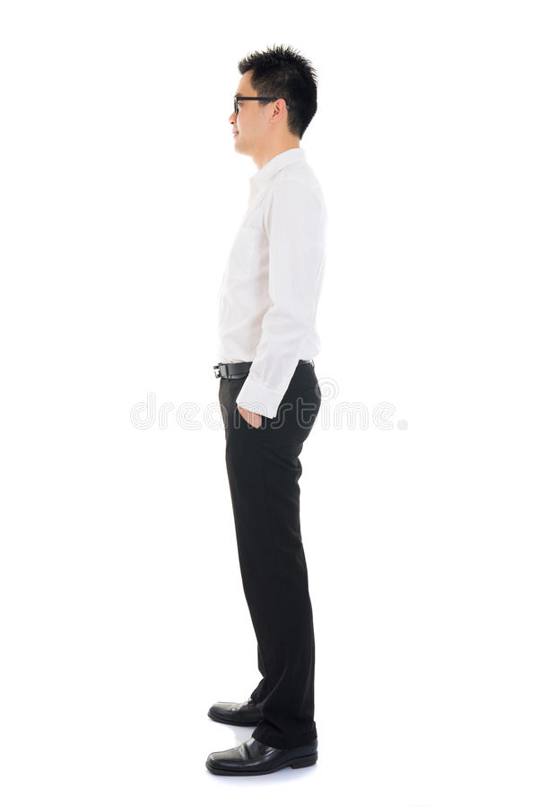 Young Asian business man full body side view isolated on white b stock image