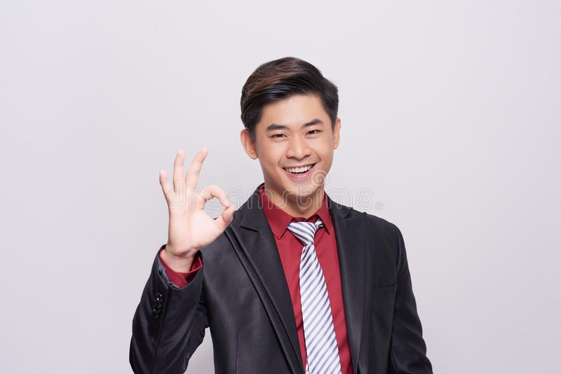 Young asian Business Man with OK hand gesture royalty free stock image