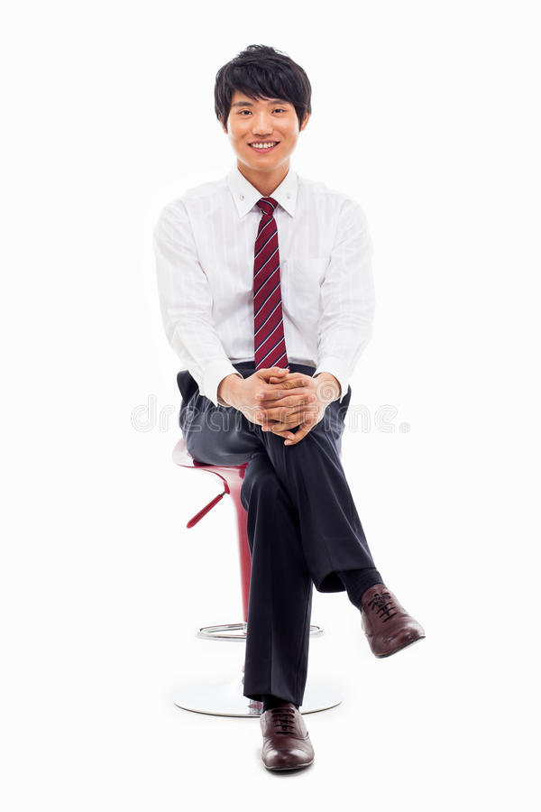 Young Asian business man sitting on the chair. stock photos