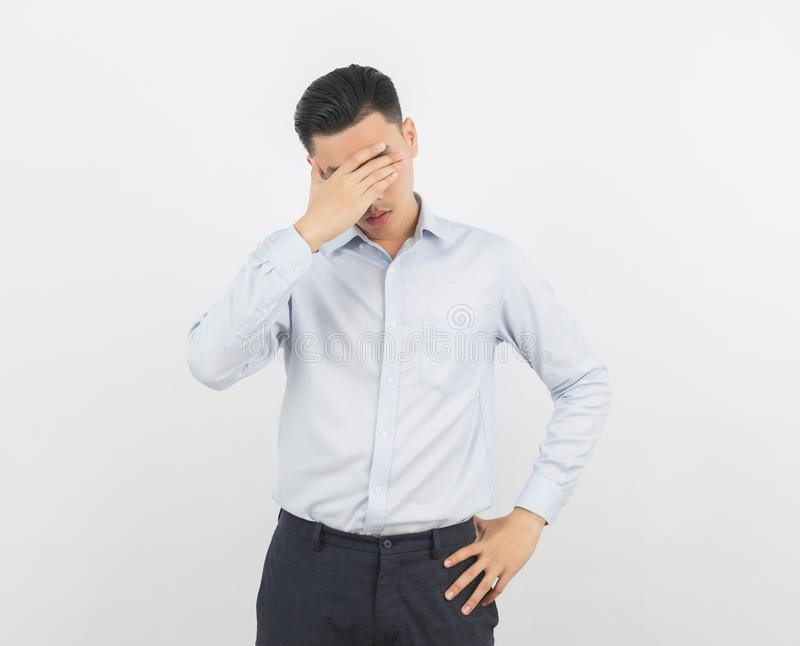 Young asian business man unhappy and frustrated with something. Negative facial expression  on white background. royalty free stock photography