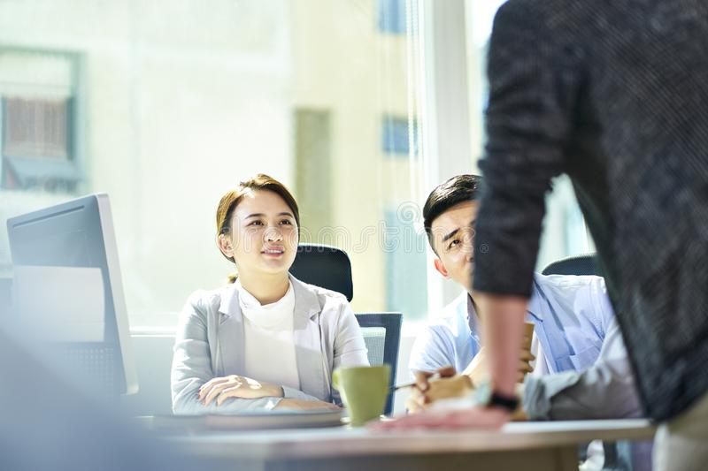 Young asian business people meeting in office stock photos