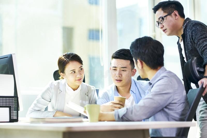 Young asian business people meeting in office stock photography
