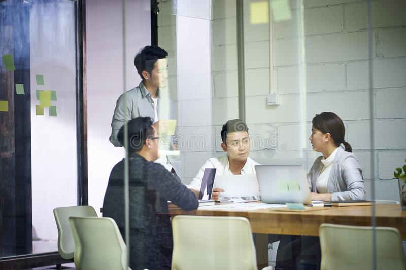 Young asian business team people meeting in office stock photo