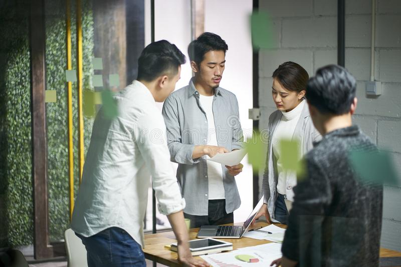 Young asian business team people meeting in office royalty free stock images