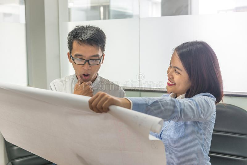 Young Asian business team working and discussing about new project royalty free stock image