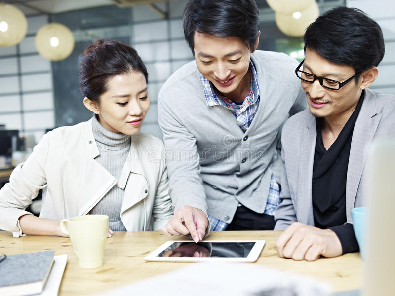 Young asian business team working in office stock images