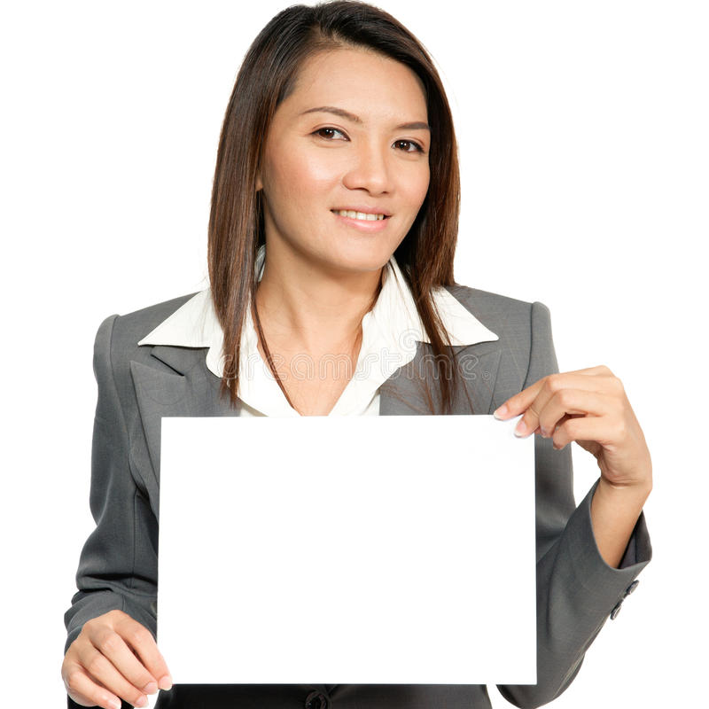 Young Asian business woman attractive brunetee showing blank signboard stock image