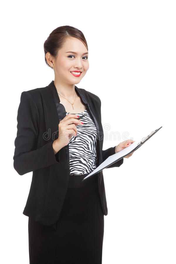 Young Asian business woman with pen and clipboard stock photo