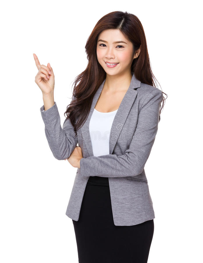 Young asian business woman pointing on copy space stock photo