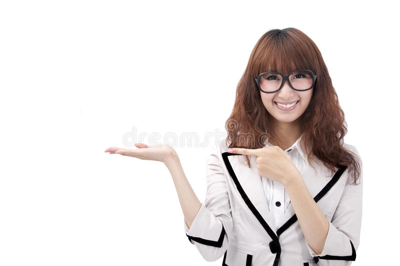Young asian business woman presenting. Beautiful young asian business woman presenting your product royalty free stock photo