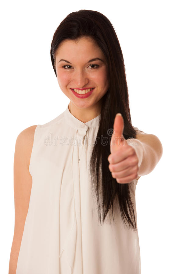 Young asian business woman showing thumb up gesturing success - stock photo