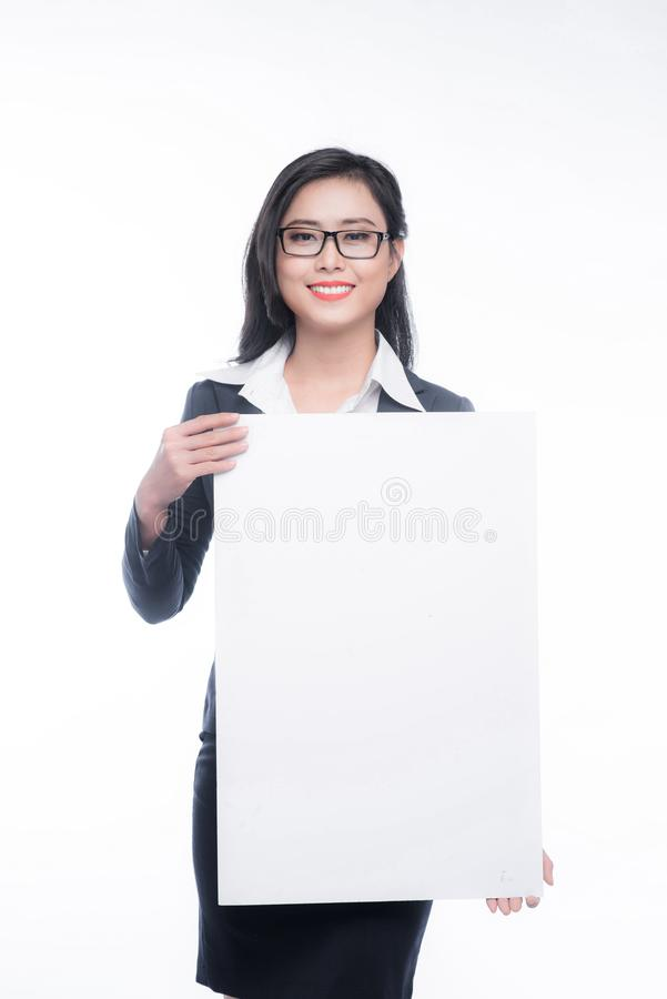 Young asian business woman showing a white board isolated on white background. royalty free stock photo