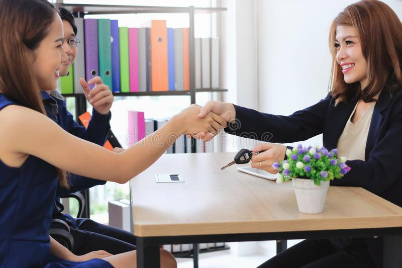 Young Asian business woman shaking hands with partners after finishing a meeting. Handshake greeting deal concept. Young Asian business women shaking hands with royalty free stock photography