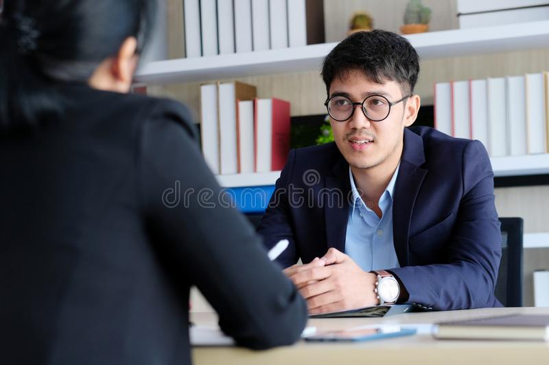 Young asian businessman at business meeting, job interview, in office, business people, office lifestyle concept. Young asian businessman at business meeting stock photos