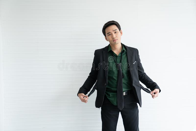 Young Asian businessman goes bankrupt from shares and business. With copy space/businessman pose /bankrupt action / economic crisis situation stock photography