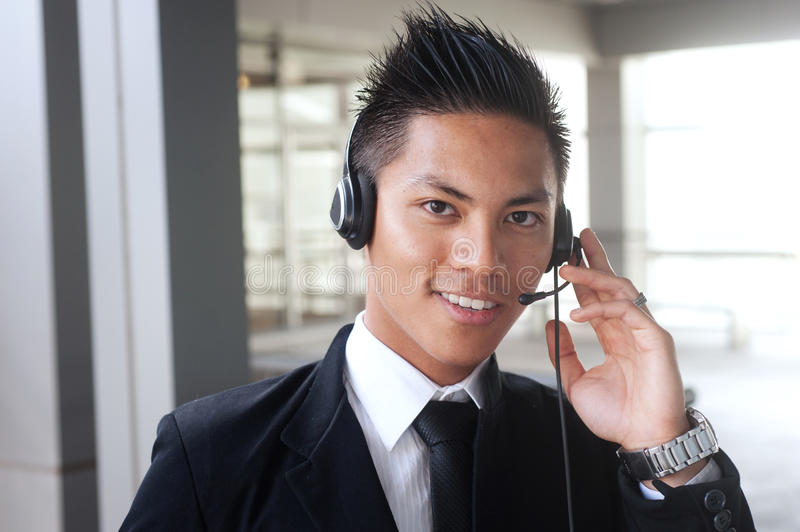Young asian businessman with a headset stock images