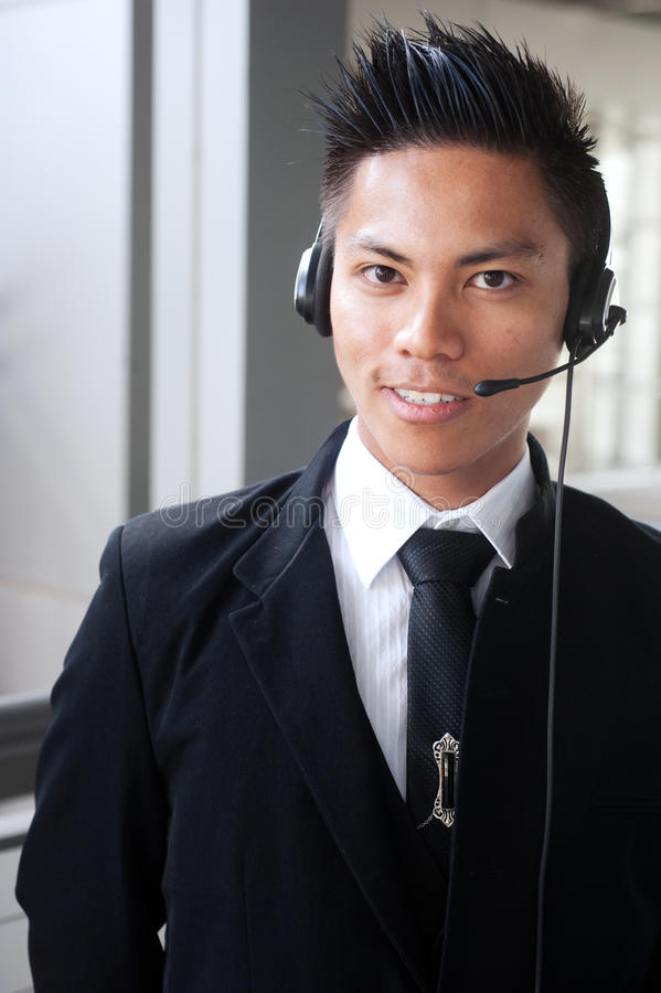 Young asian businessman with a headset stock image