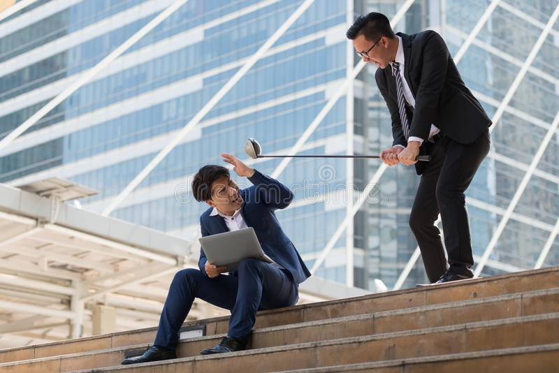 Young Asian businessman holding golf clubs quarrel are going to stock images