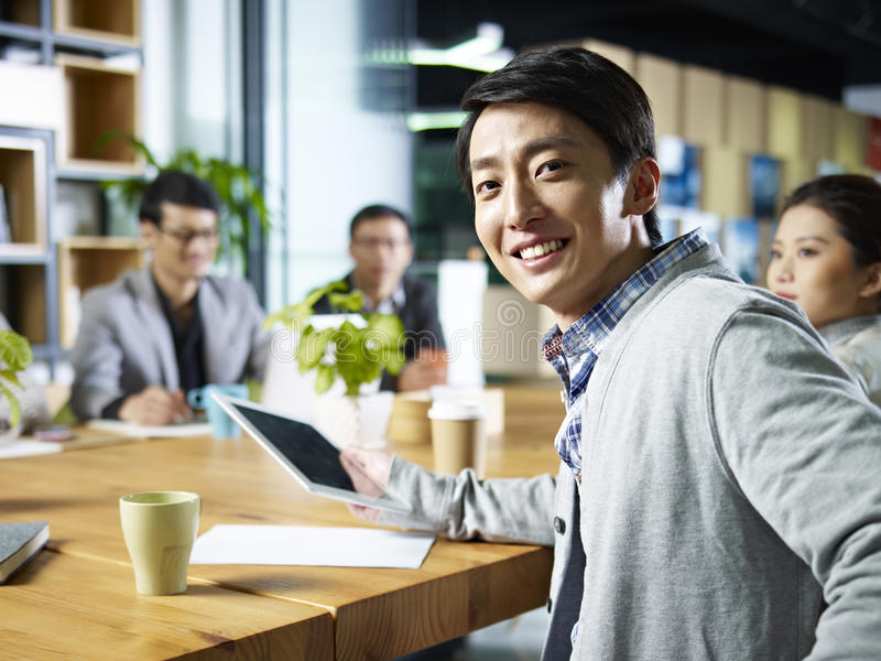 Young asian businessman looking at camera royalty free stock images