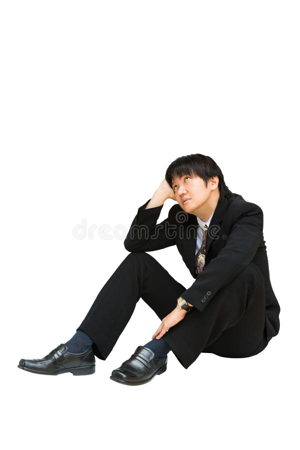 Young asian businessman sitting and looking up above his head stock photo