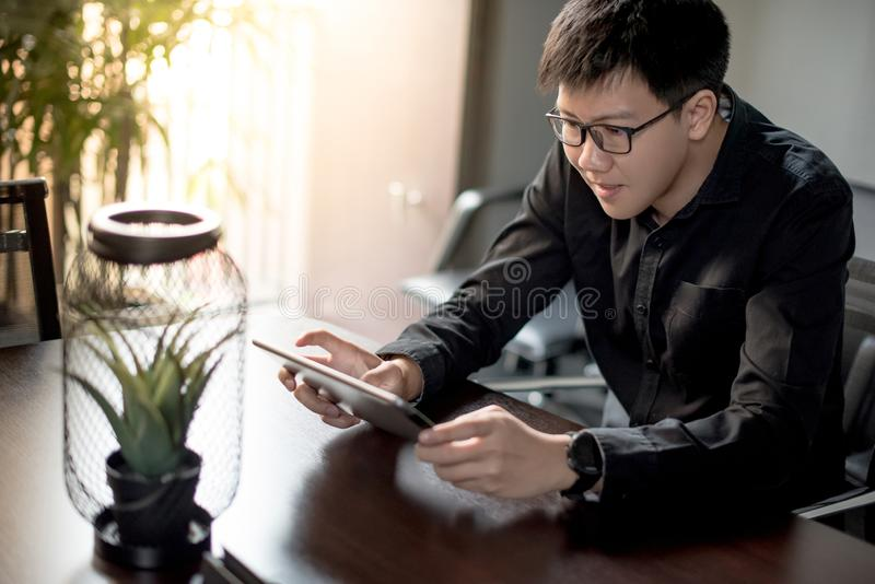Asian businessman using digital tablet in office stock images