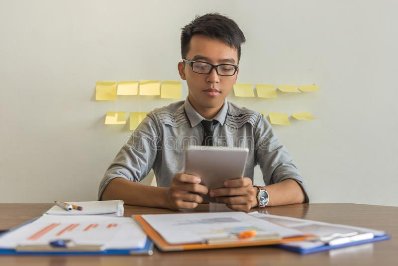 Young businessman using tablet in the office royalty free stock photography