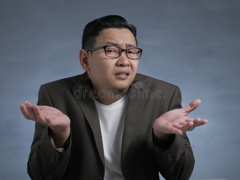 Young Businessman Indifferent Gesture stock photos