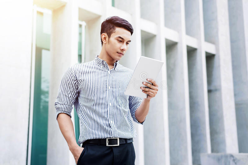Young Asian Businessman working on tablet, Lifestyle of modern m royalty free stock images