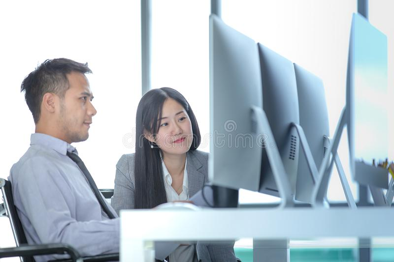 Young Asian businessmen are working together in modern office. T royalty free stock photography