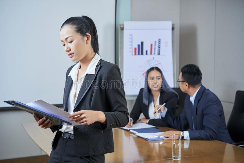 Businesswoman getting ready for presentation stock images