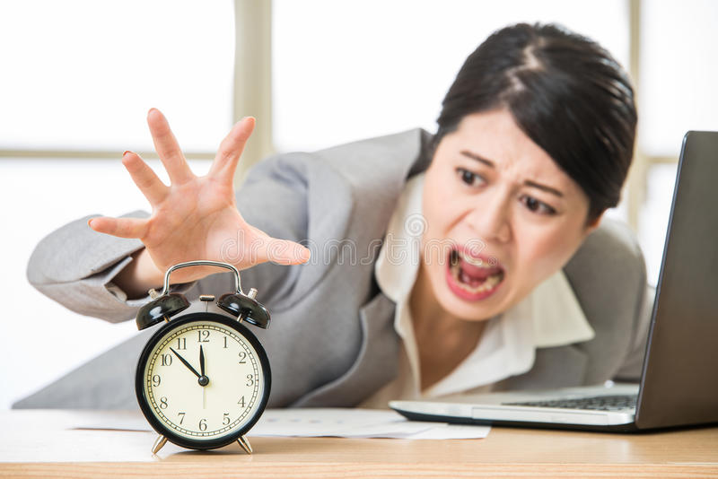 Young asian businesswoman want to holding time royalty free stock images
