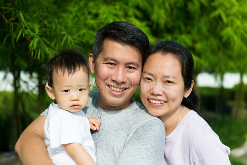 Young Asian Chinese family outdoor royalty free stock image