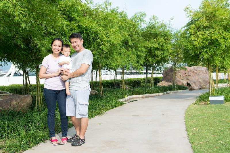 Young Asian Chinese family outdoor stock photo
