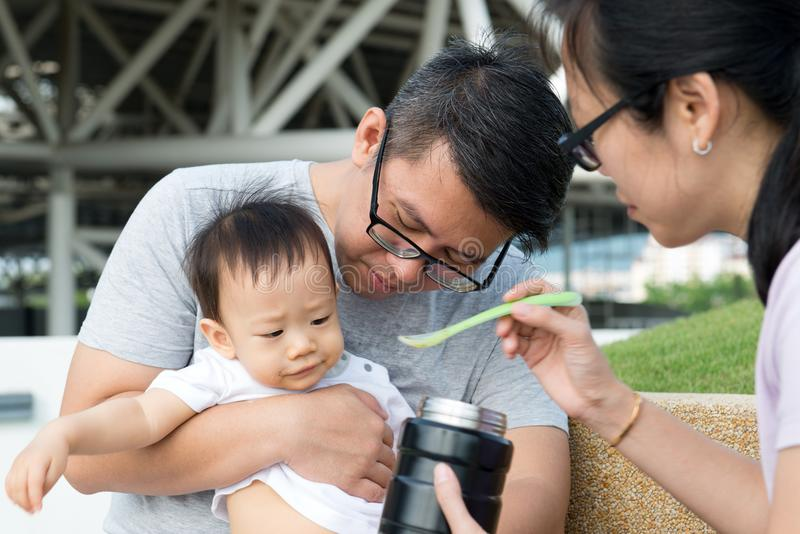 Young Asian Chinese family outdoor royalty free stock photos