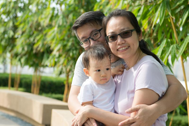 Young Asian Chinese family outdoor stock photography