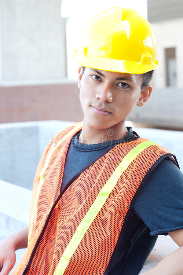 Young asian construction worker royalty free stock photo