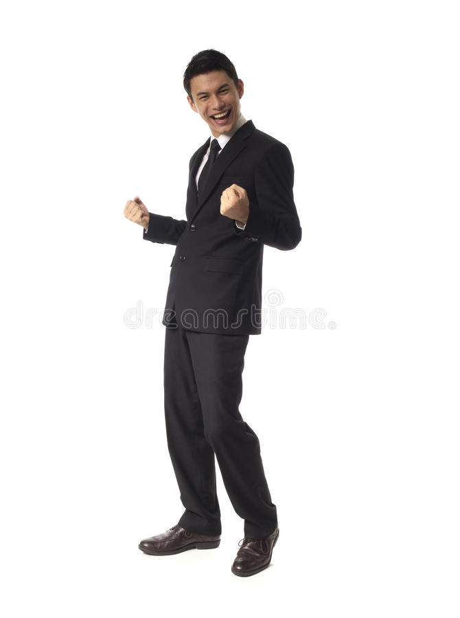 Young Asian Corporate Man Double Fist Pump Stock Photo