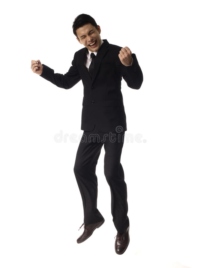 Young Asian Corporate Man jumping with fist pump. Over white background royalty free stock image