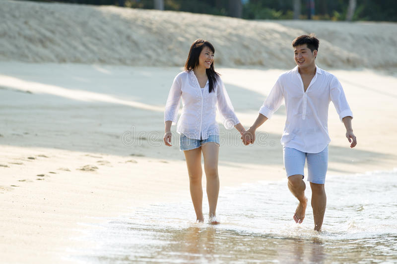 Young Asian Couple On The Beach. Stock Images