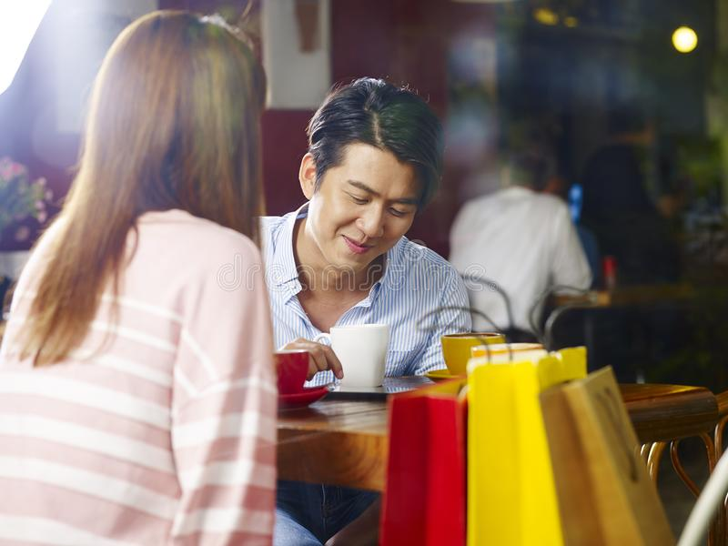 Young asian couple chatting in coffee shop stock images