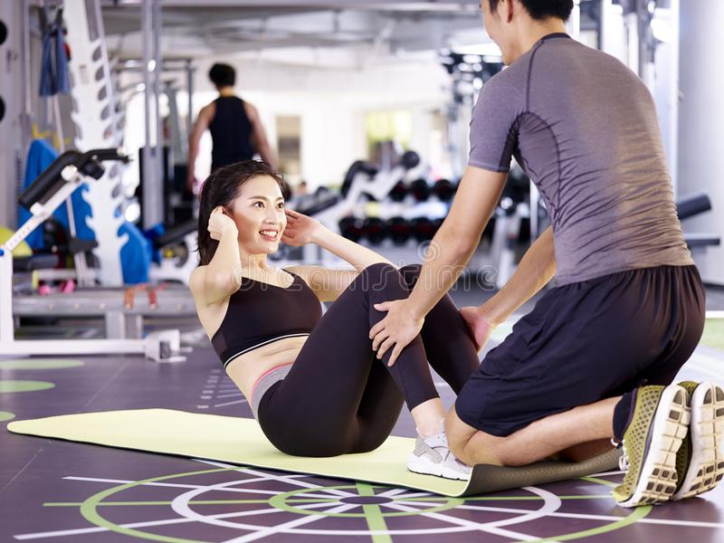 Young asian couple exercising in gym royalty free stock images