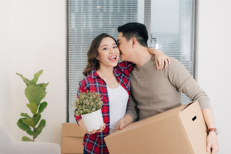 Young asian couple moving to a new apartment together relocation stock image